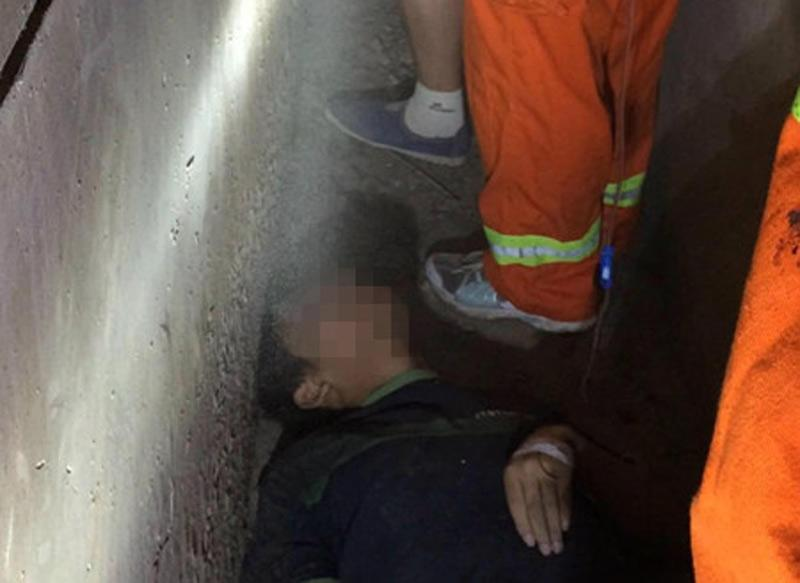 Boy gets stuck between 2 buildings after failed suicide attempt