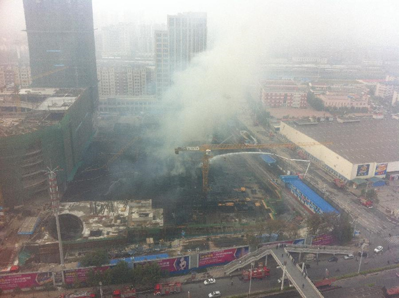 Shopping mall under construction catches fire in Tianjin