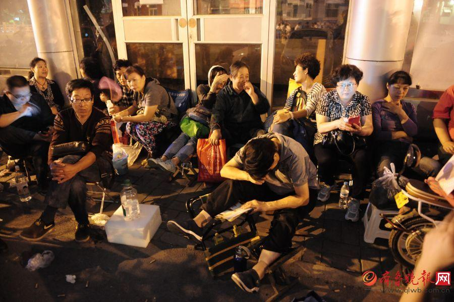 Public housing applicants queue for two nights to submit forms