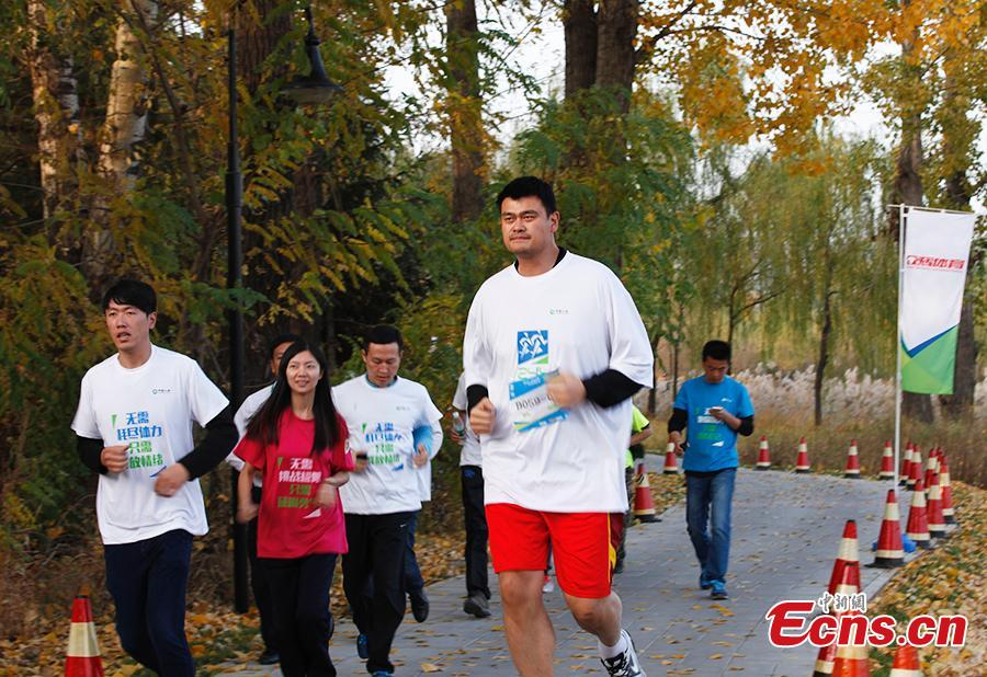 Yao Ming takes the lead in long-distance relay race