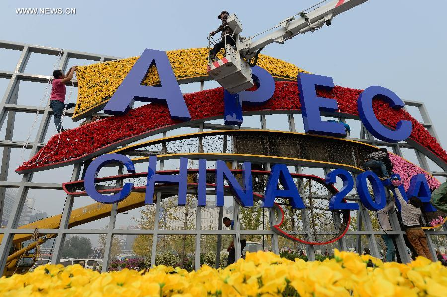 Flower decoration set up for upcoming APEC meeting in Beijing