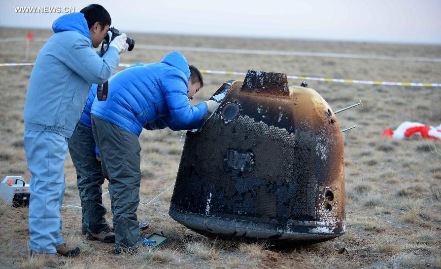 China's unmanned lunar orbiter returns home, first in nearly four decades