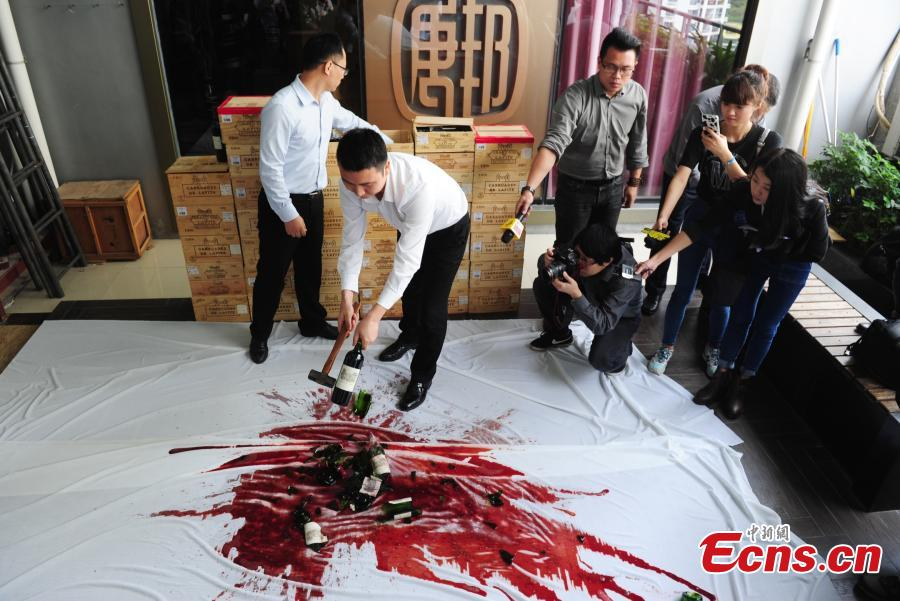 Wine dealer smashes fake Chateau Lafite in Shenzhen