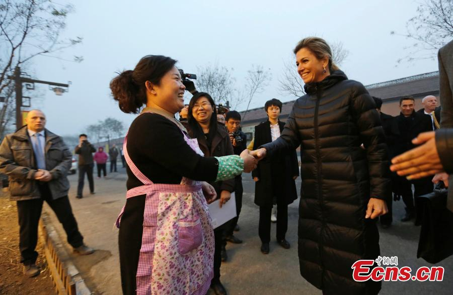 Dutch royal visits noodle restaurant in Beijing village