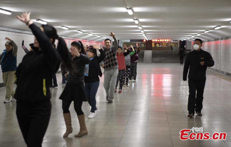 Chinese 'dama' dance at underground passage