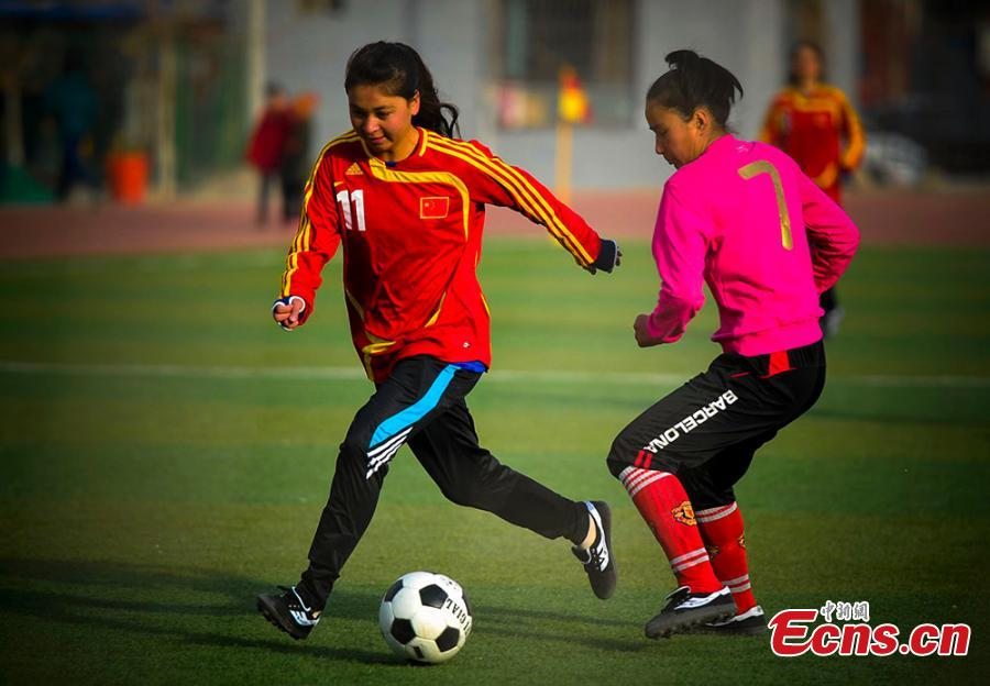 Passion for football brings girls together in Xinjiang's prefecture