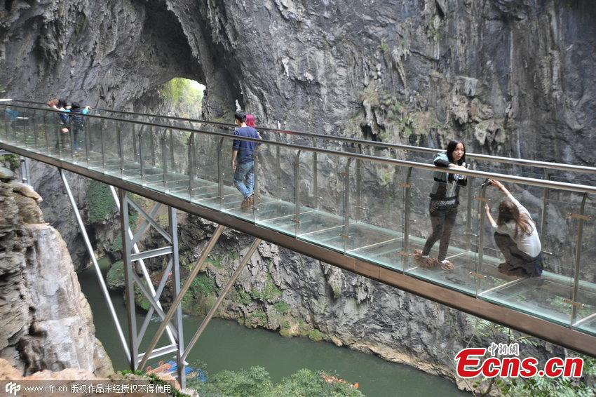 Transparent plank road draws visitors to ancient cave