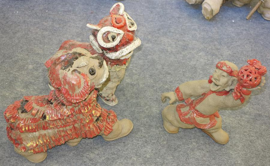 Handcrafted mud statues displayed in Weifang