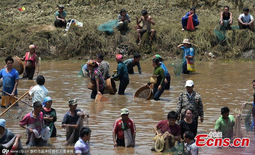 Fish catching festival held in SW China