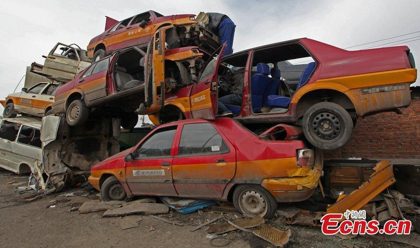 City overwhelmed by scrapped cars