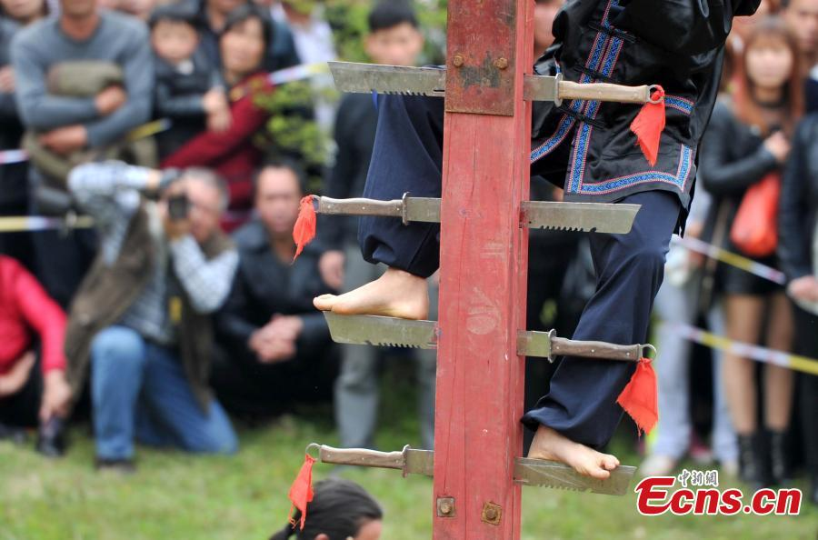 Knife-ladder-climbing show staged to mark Double Third Day