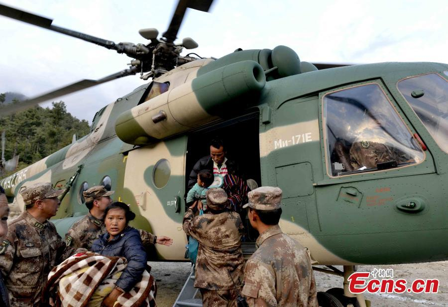 Military helicopter helps in quake zone