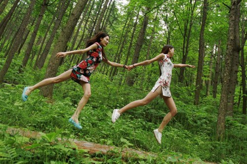 Qipao-clad students float in forest