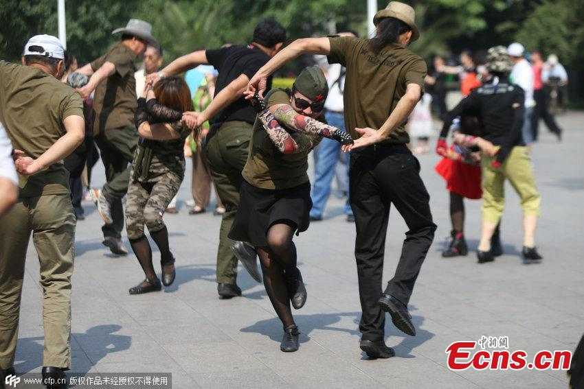 Square dancers in military costumes attract crowds