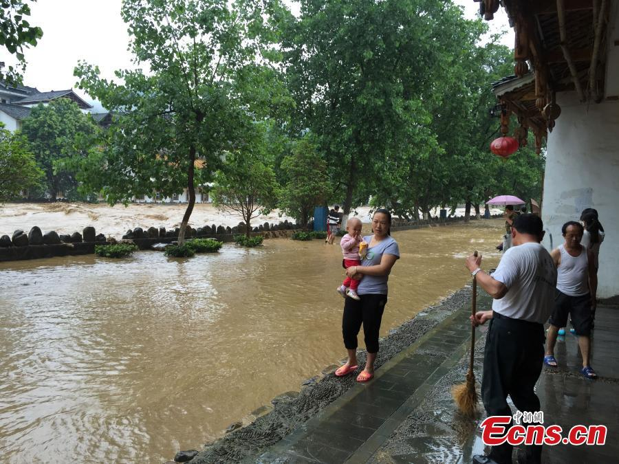 SW China county hit by downpours and floods