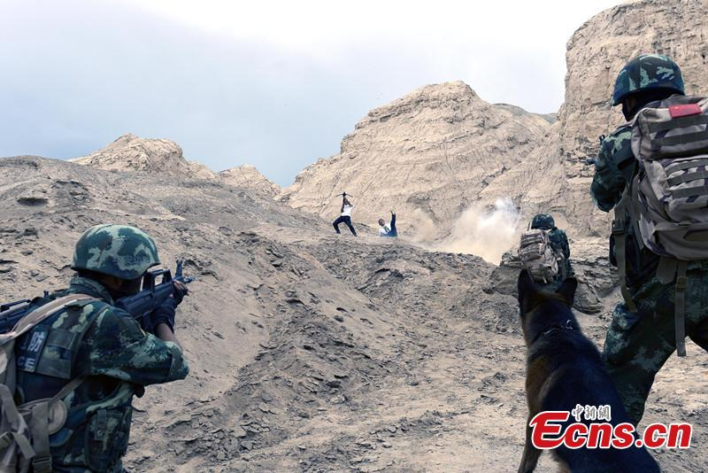 Frontier soldiers take part in combat drill in NW China's Xinjiang