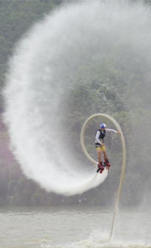 Waterskiing stunt performance at cultural festival
