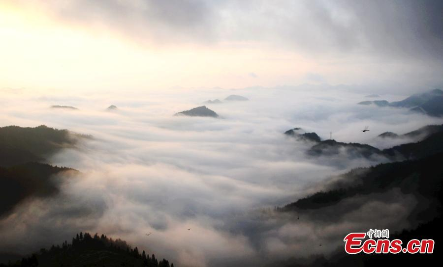 Clouds, fog create remarkable mountain scene