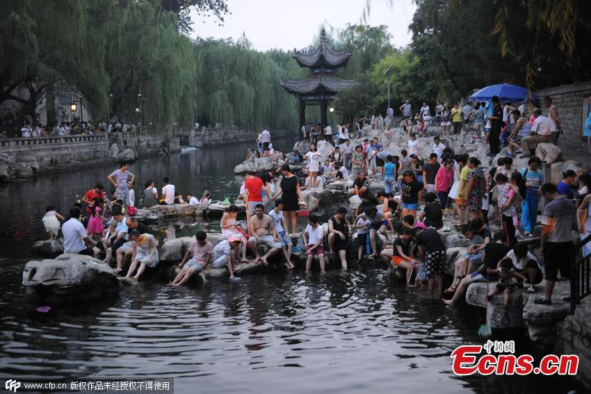 Tourists take footbath in famous spring