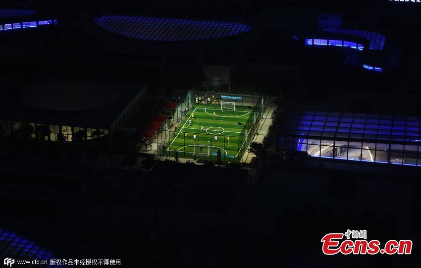 Shopping mall builds mini football field on rooftop