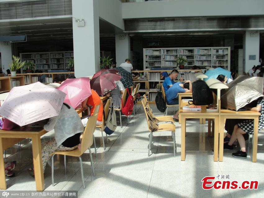 Readers need umbrellas to read in library
