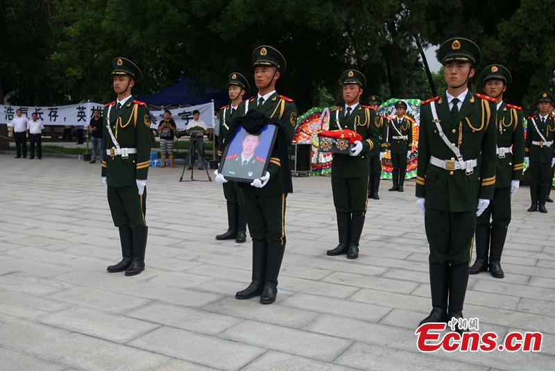 Funeral for Chinese guard killed in Somalia