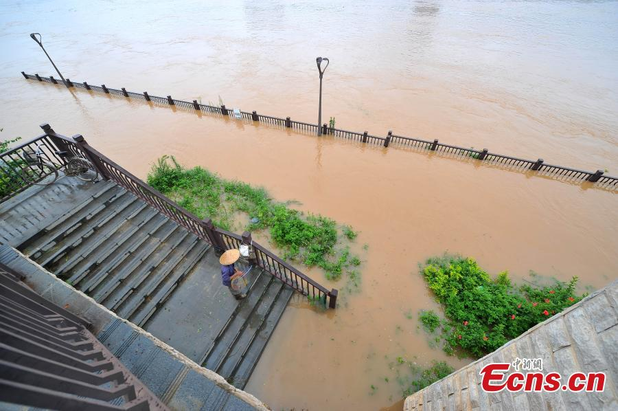 River floods landscape roads in SW China city