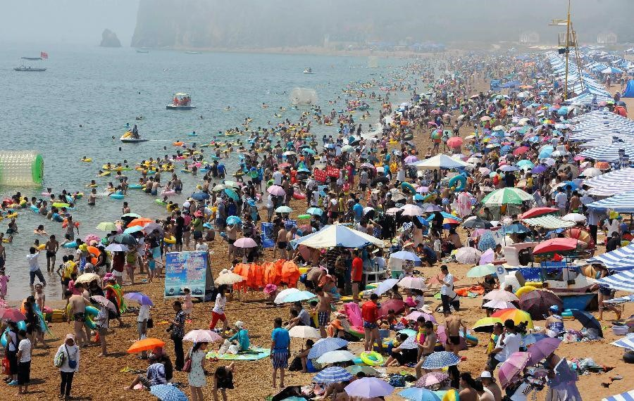 China issues yellow alert for heat