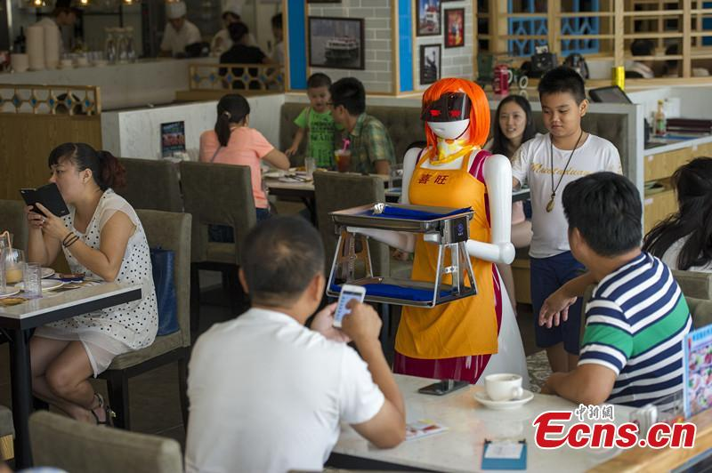 A robot waitress works for a restaurant in Haikou