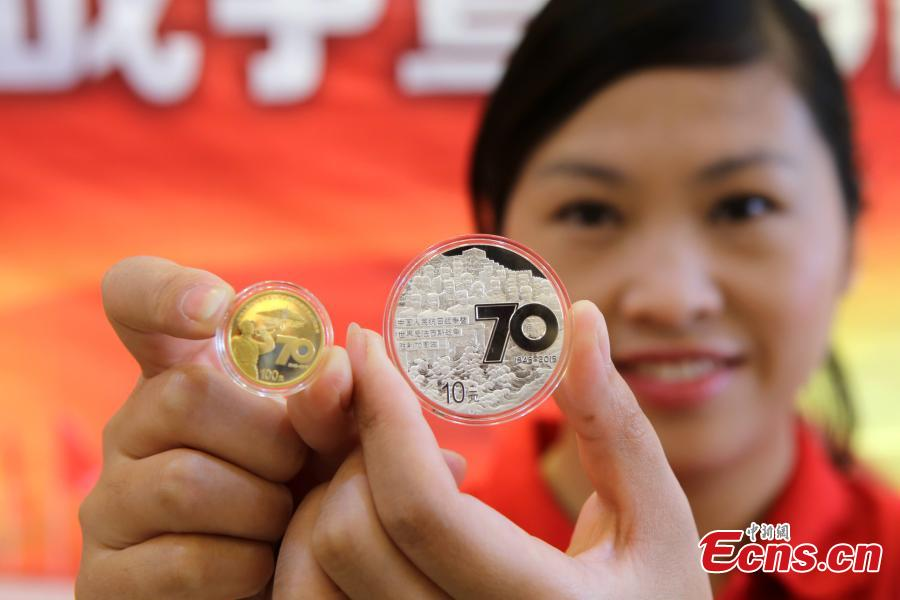 Commemorative coins for war anniversary debut in C China city