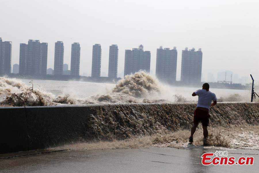 'Ghost King Tides' at Qiantang River drench spectators