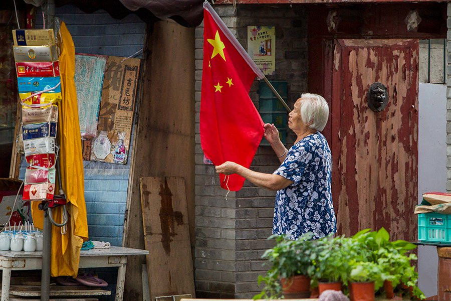 National flags hung on buildings in Beijing