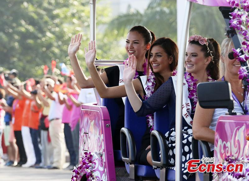 Miss World 2015 contestants take part in parade in Sanya