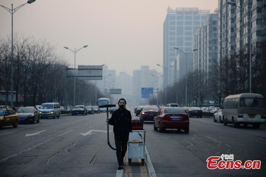 Man turns Beijing smog into brick