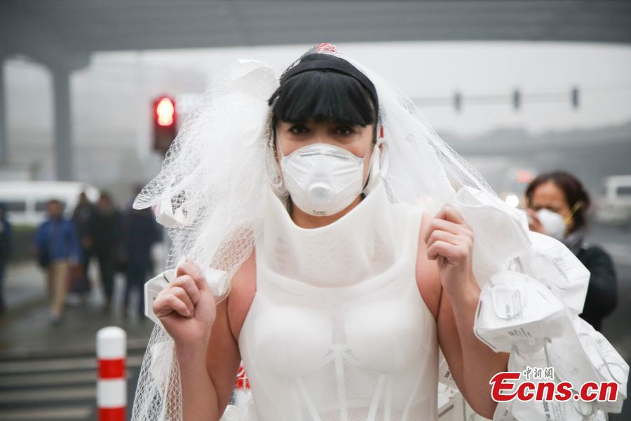 Artist creates wedding dress out of smog masks