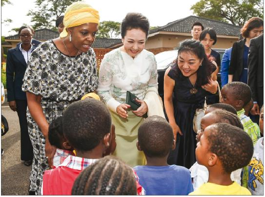 First lady Peng Liyuan visits Grace Mugabe Children Foundation in Harare