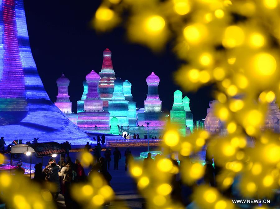 Tourists view shimmering ice sculptures in China's Harbin