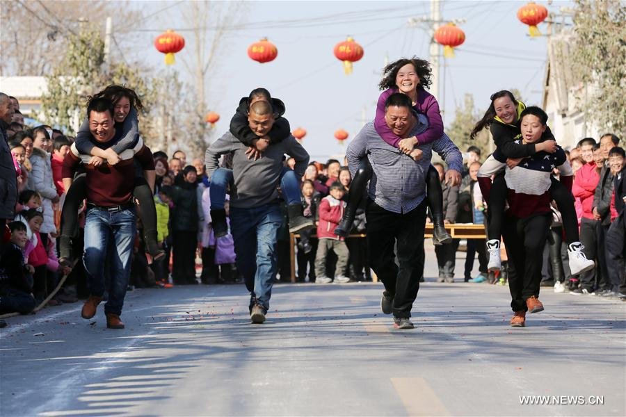 Wife-carrying contest held during celebrations in C China