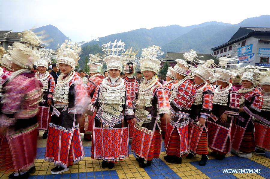 Miao ethnic people participate in dancing contest for Spring Festival