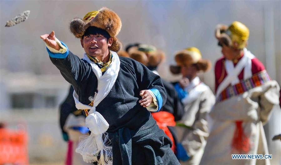 People 'hit the horn' to celebrate Tibetan New Year in Lhasa