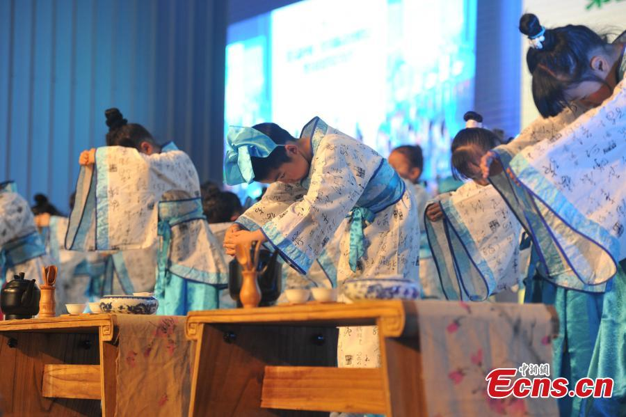 Pupils perform tea drinking protocols at expo