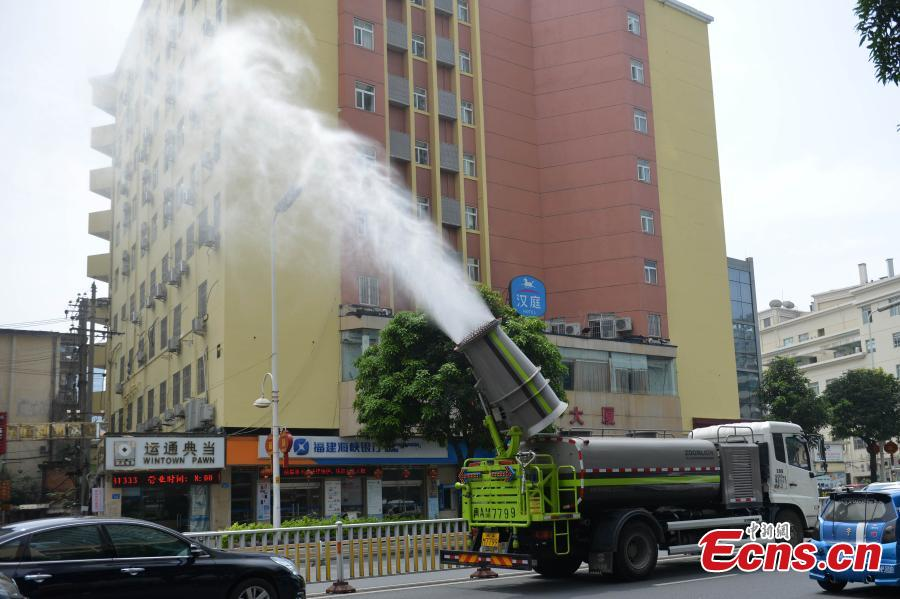 Water sprayers used to fight sultry weather