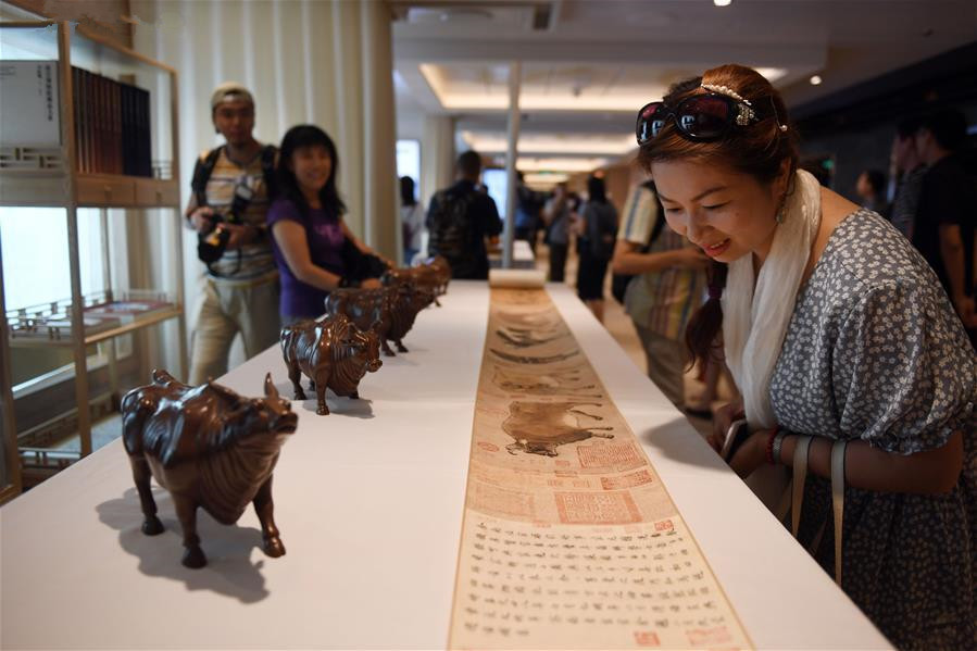 Cultural products of the Palace Museum displayed on Royal Caribbean's cruise ship in Tianjin
