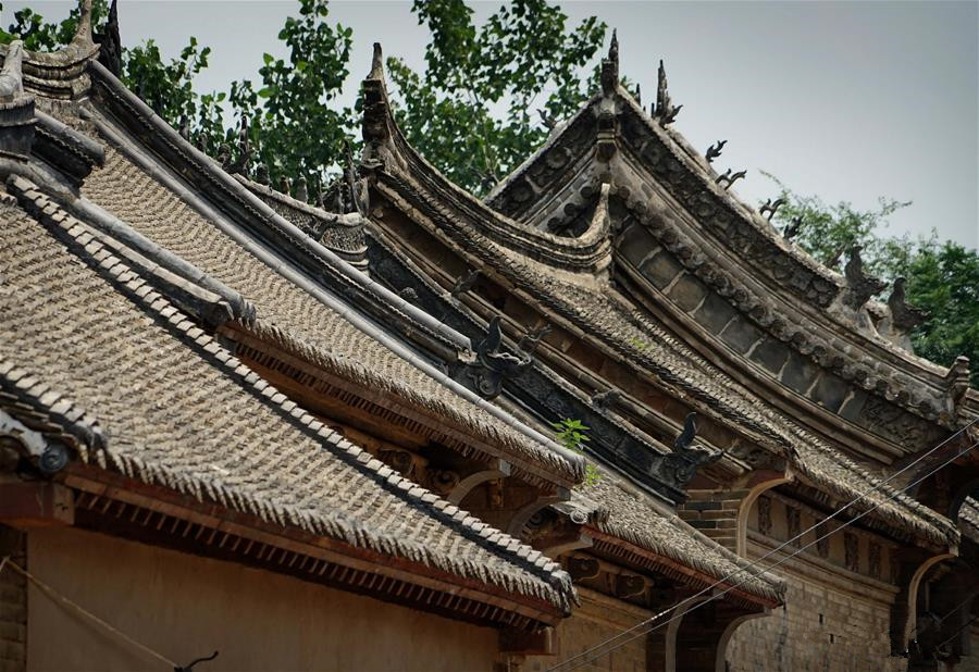 Linfeng village features complex built with red rocks in Henan