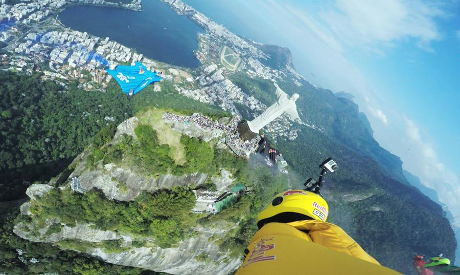 Wingsuit flyers soar over Christ the Redeemer statue