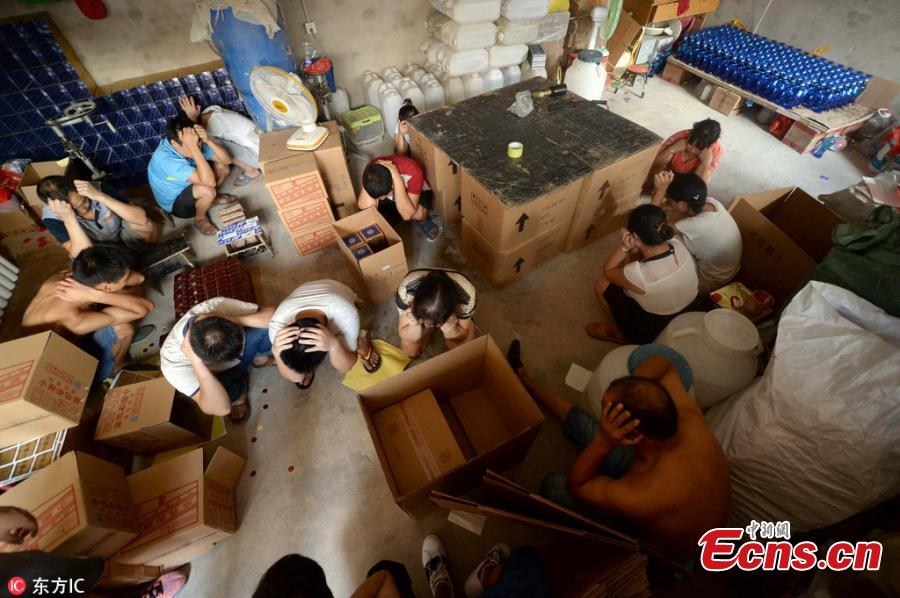 20 caught making fake liquor in Beijing