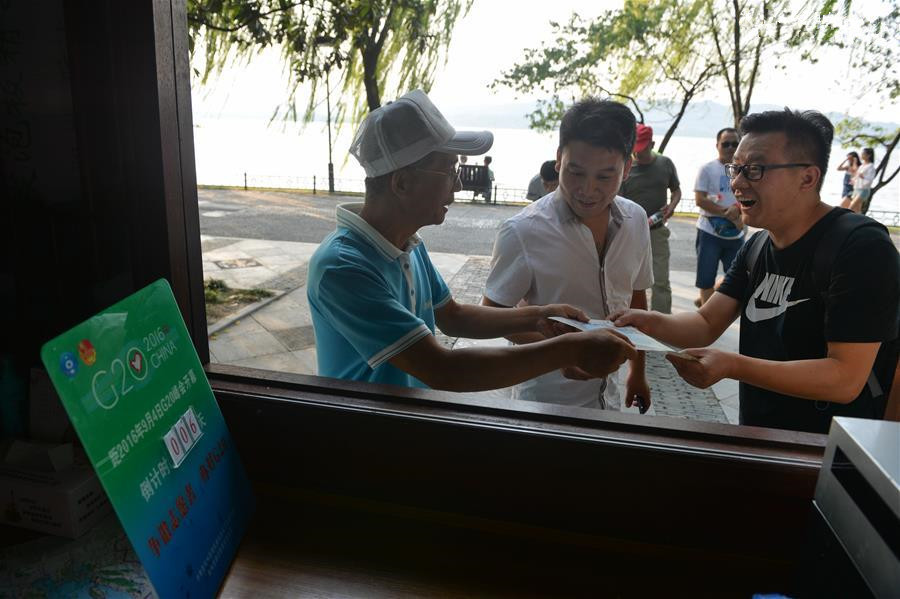 64-year-old volunteer serve tourists before G20 summit