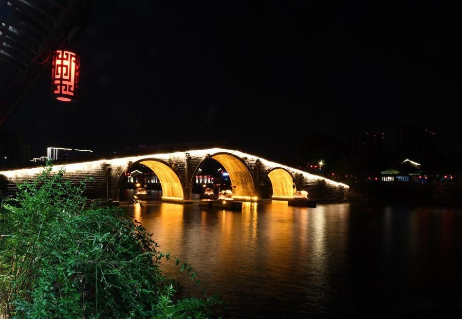 Night view of Gongchen Bridge stretching over Great Canal in Hangzhou