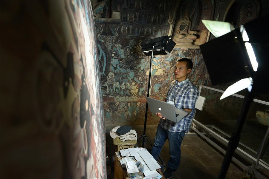 Films based on murals in cave of Mogao Grottoes completed