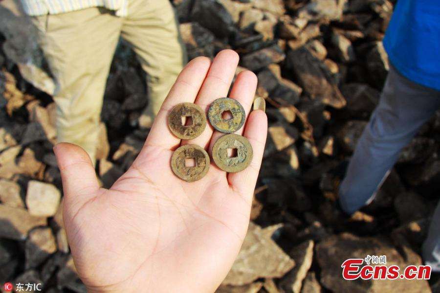 Farmers rush to dig for ancient coins on mountain